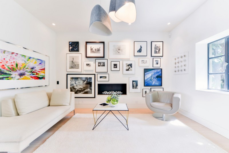 wall decorating ideas for living room daybed upholstered chair framed artworks beige floors window pendants ceiling lights industrial design