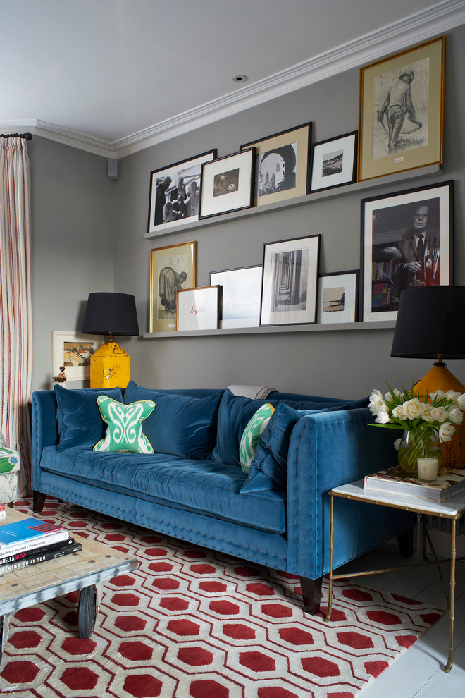 wall decorating ideas for living room sofa coffee table carpet sidetable lamps artworks grey walls transitional design
