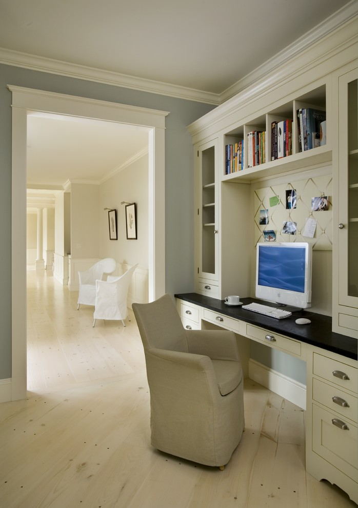 wall units with desk cabinets shelves books chair light coloured floor computer traditional home office
