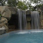 Waterfalls For Pools Slide And Big Waterfall Stone Design Flintstone Feel Pool Slide For Kids Spacious Cave Gray Pool Tiles