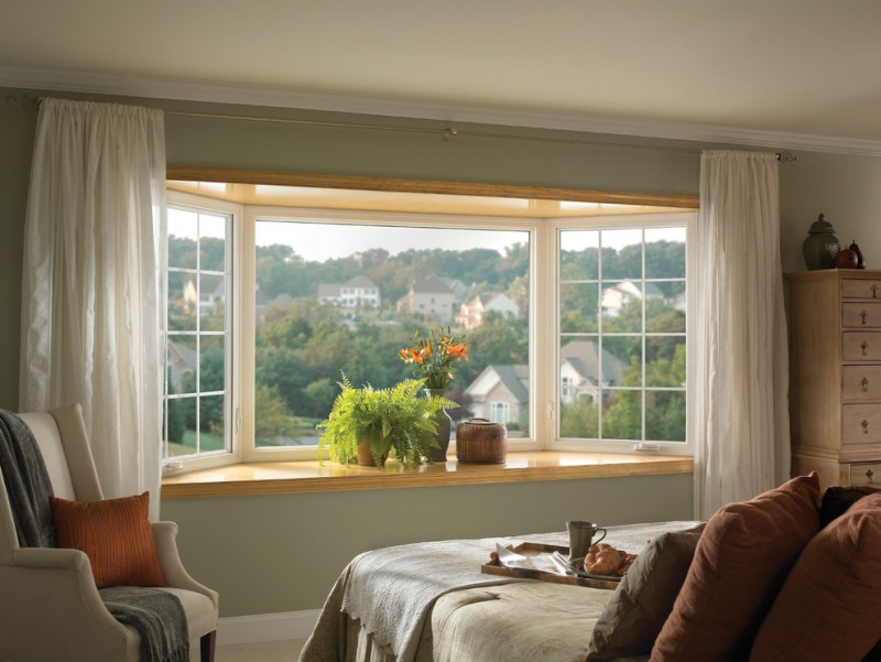 window treatment ideas for bay windows ledge table light brown wood drawers white drapery greenhouse window bedroom window bed cushioned armchair
