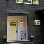 yellow craftsman style front door lamp chair windows decorative plants victorian entry