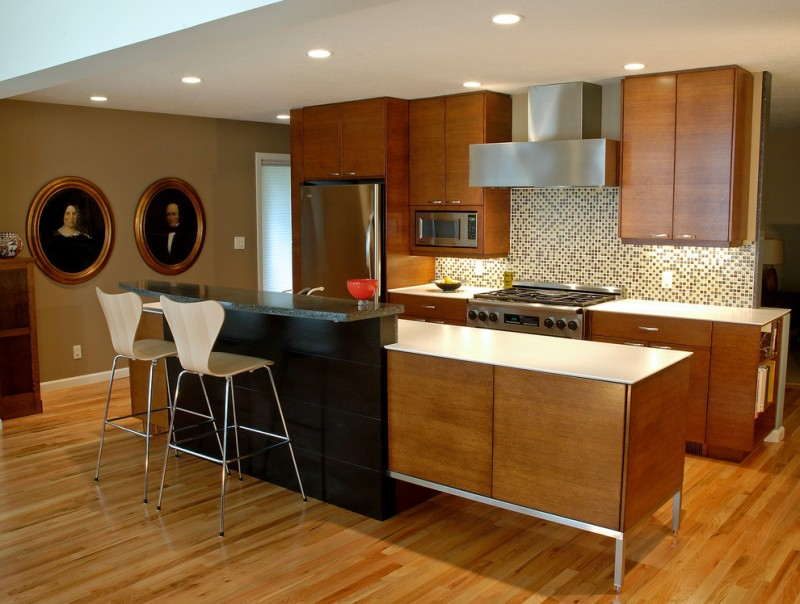 Eclectic with modern design countertops and the picture in the kitchen, dark woods and light woods cabinets, stainless legs on island