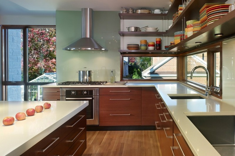 L shape hanging industrial kitchen shelves L shape countertop in white dark toned flat panel cabinets square shaped undermount sink electric stove stainless steel appliances white top kitchen island