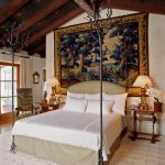 Mediterranean Bedroom Design Spanish Style Bed Frame With Headboard And Decorative Trees As Ornaments Spanish Style Bedside Tables With Table Lamps Huge Painting Exposed Beams On Ceilings