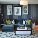 Trendy Living Room Photo With Gray Walls And Light Hardwood Floors Black Suede Sofa Accent Rug Light Toned Wooden Floors Pinstripe Walls