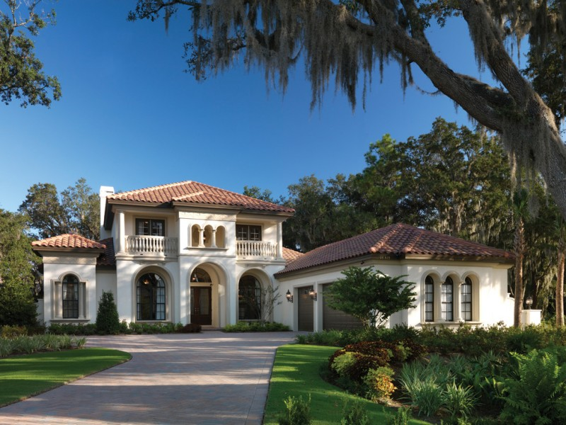 Tuscan two story exterior home white base with creamy trim a cornice molding hipped roof with projecting wings cream exterior wall paint