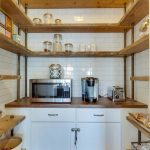 U Shaped Industrial Shelves For Kitchen Supported By Pipes And Made Of Hardwood Wood Top Countertop Small Sized Microwave Modern Coffee Maker Flat Panel Cabinet In White