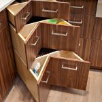 Artistic Corner Cabinet Idea With Raised Handles Made Of Stainless Steel