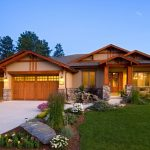 Arts And Crafts One Story Exterior Home Design With A Gable Roof Concrete Front Yard Wooden Pillars And Garage Doors Stone Pillar Base With Exposed Mortar