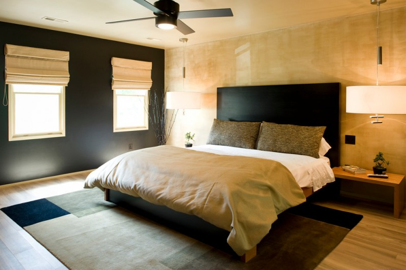 asian themed bedroom quarto ceiling fan thick blue and dark cream rug black bed and headboard cream wall window shades