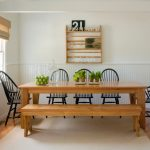 Beach Style Dining Room With Wooden Table And Benches And Windsor Chairs White Painted Wall Rattan Shade Floating Cabinet Light Toned Wooden Floors