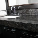 black and white granite countertop black cabinet black mirror border undermount sink stainless steel faucet wall mirror