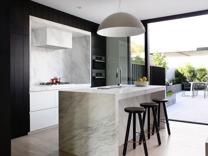 black and white kitchen black modern stool hidden range hood dome pendant carara marble kitchen island minimalist kitchen cabinet