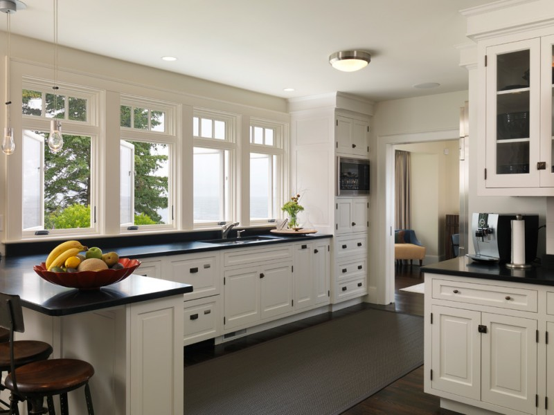 black and white kitchen drop pendant light paper holder kitchen carpet hardwood flooring kitchen windows wood barstools black countertop