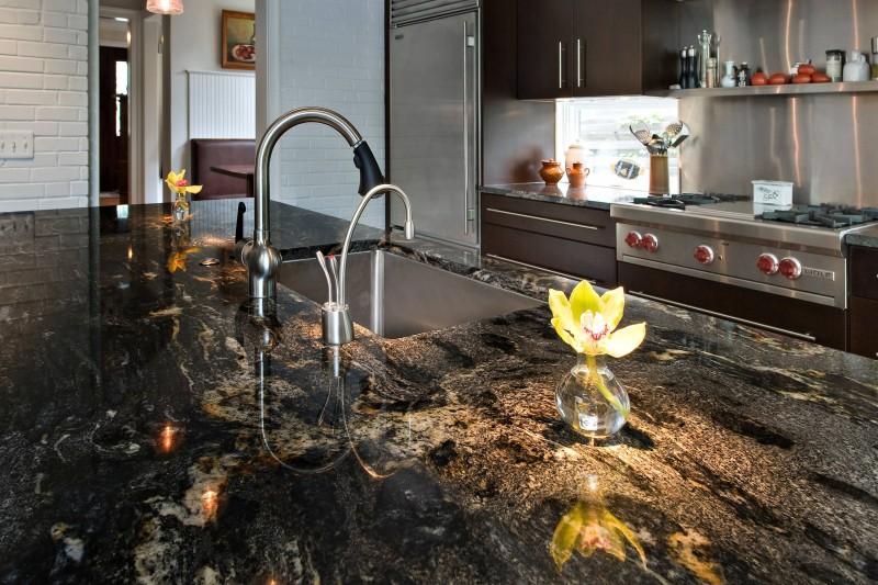 black countertop stainless steel faucet stainless steel appliances flowering undermount sink stainless steel backsplash tiled wall
