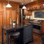 Black Wooden Kitchen Island With Black Marble Countertop And Black Metal Stool With Cuhion On Top
