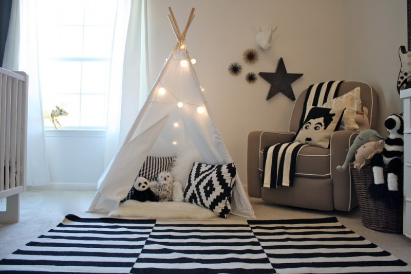 boys' playroom idea monochromatic fabric area rugs white decorative tent dark beige corner sofa beige walls with sea animal decorations