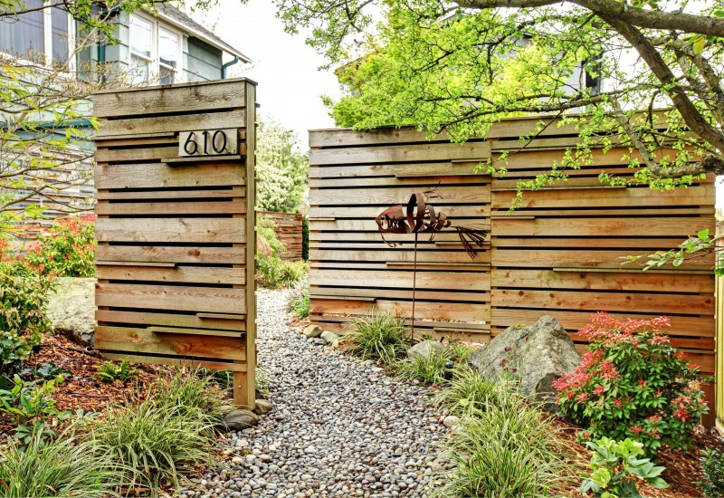 cedar fence entry space garden flower stone pathway