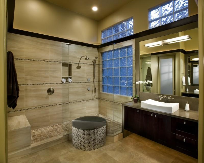 circular mosaic shower bench mosaic tiled wall glass brick glass slides porcelain floor floating vanity vessel sink bar light