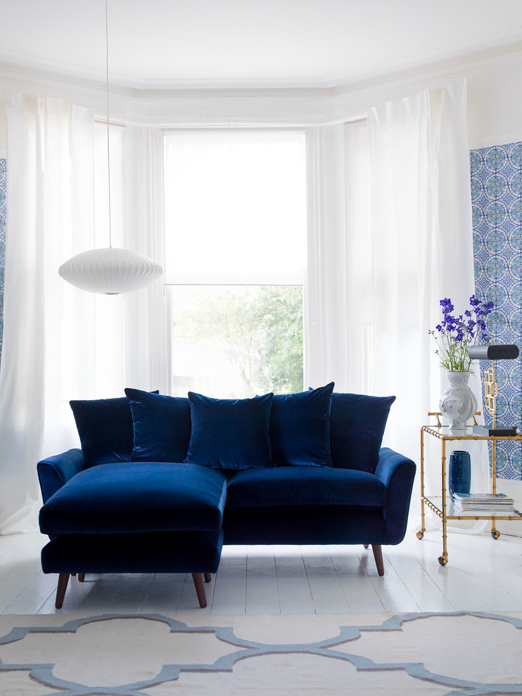 classic modern sofa in navy blue white ceramic tiles floors golden finishing movable side table white rug with light blue motifs