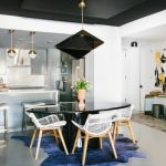 Contemporary Dining Room Oval Shaped Dining Table In Glossy Black Modern White Dining Chairs With Wood Legs Blue Area Rug Unique Pendant Lamp In Glossy Black White Floors