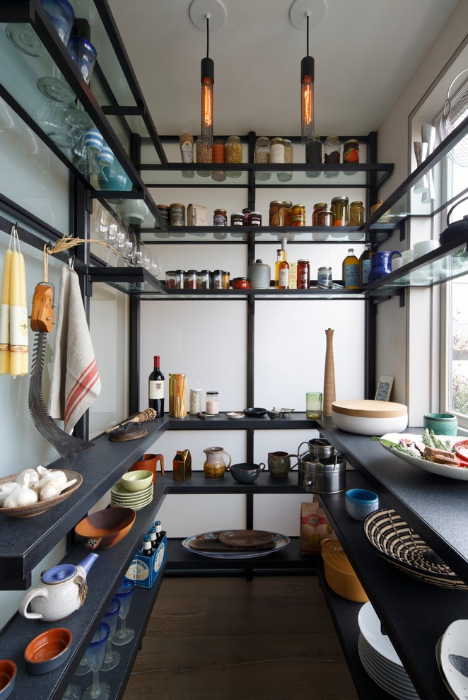 contemporary kitchen idea with industrial glass shelves suspended by lightweight metal bars or wires