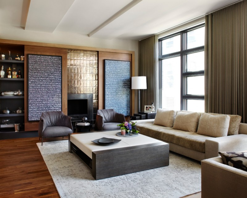 contemporary living room with leather furnitire set grey area rug medium toned wood floors custom fireplace sliding walls with hidden shelving
