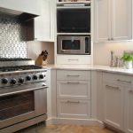 Corner Cabinets And Shelves In White Solid White Countertop White Backsplash Stainless Steel Appliances Porcelain Tiles Floors