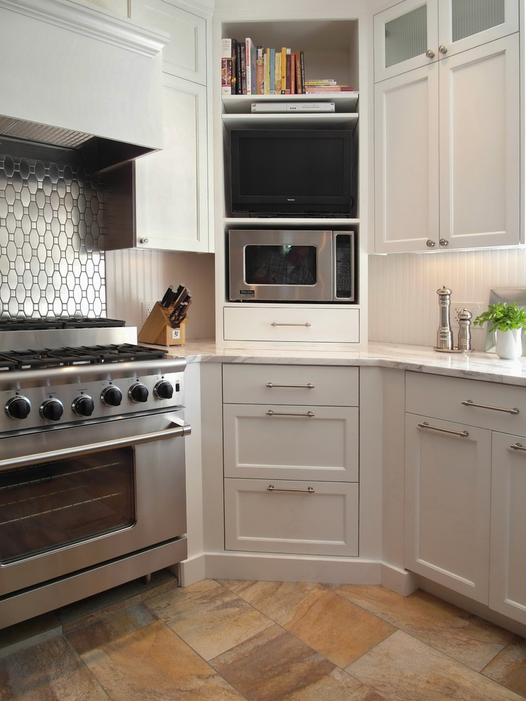 corner cabinets and shelves in white solid white countertop white backsplash stainless steel appliances porcelain tiles floors