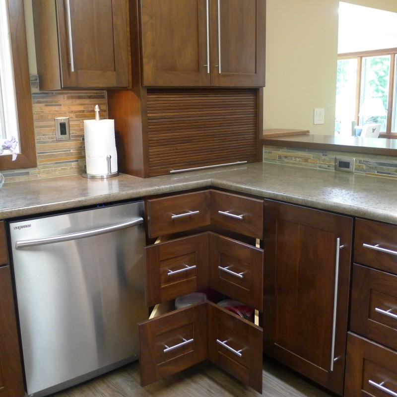 custom made corner cabinet made of walnut in dark toned wood color HD laminated countertop stainless steel appliances