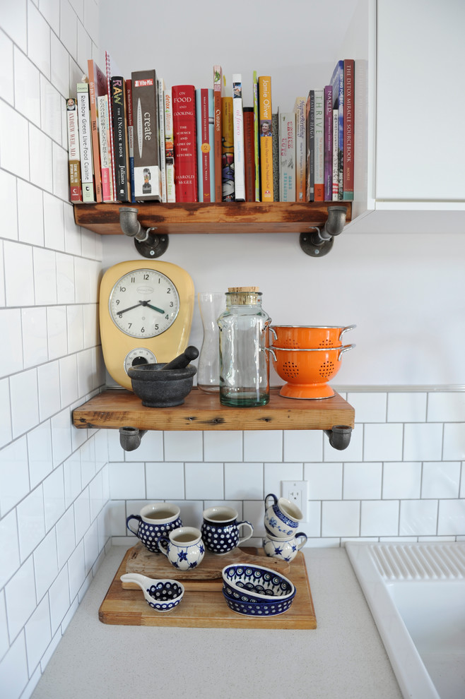 eclectic kitchen design with small sized industrial shelves at the corner small decorative cups small decorative items books