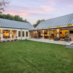 Farm Style House Plans Large Grass Yard Garden Sliding Glass Door And Window Metal Roof Patio White Home Pillar