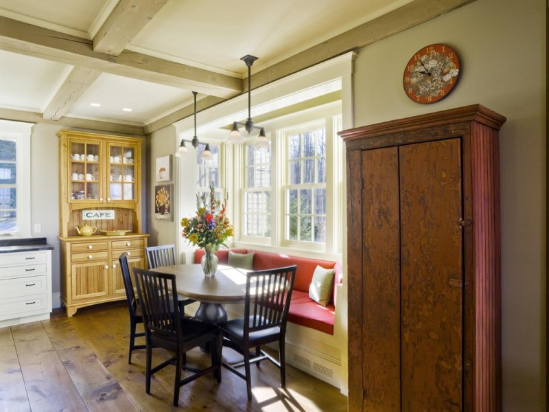 farmhouse eating area with two corner cabinets black finishing dining chairs corner dining bench with accent pillows