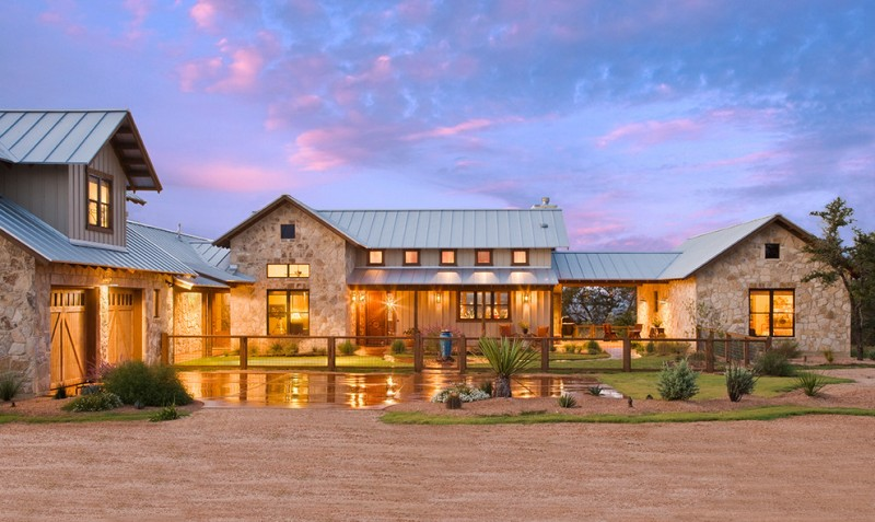 farmhouse exterior with stone wall and exposed mortar wooden doors glass windows