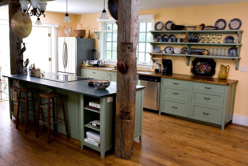 farmhouse kitchen idea with industrial open shelving over countertop wooden countertop grey kitchen cabines wooden bar stools medium toned wood floors a couple of log pillars inside the cooking room