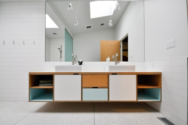 floating bathroom vanity with baby blue and white laminate square shaped & white sink stainless steel faucets frameless mirror white ceramic subway tiles walls