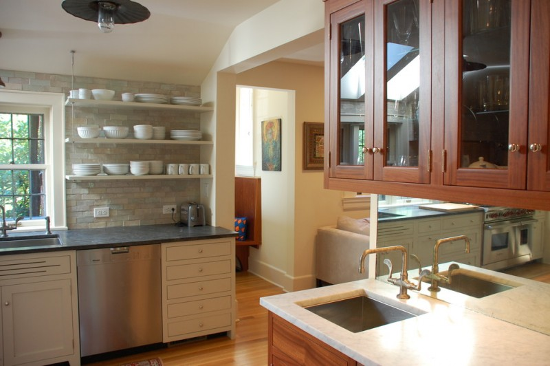 hanging white kitchen shelves black countertop stainless steel appliances white drawer system hanging wood cabinets with glass door white stone tiles backsplash undermount sink in square sh