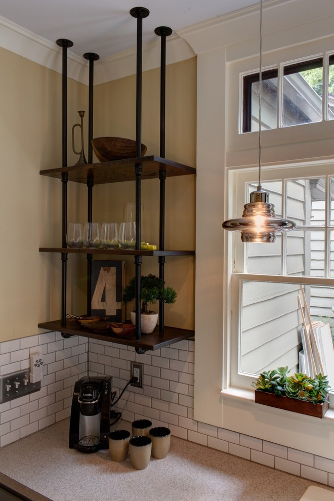 industrial kitchen idea with industrial shelving made of recalaimed wood and black stained metal pipes
