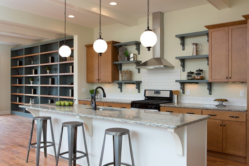 industrial kitchen with gray finished industrial shelves stainless steel appliances gray finishing decorative rack granite top island with white painted base wooden kitchen cabinets granite countertop