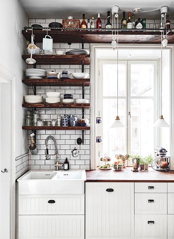 industrial open shelves made of dark toned hardwood white subway tiles backsplash flat panel cabinets in white glass windows lower pendant lamps