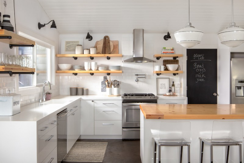 industrial shelves made of wooden and pipe supporters wood top island with white bar stools L shaped white countertop flat panel cabinets glass windows stainless steel appliances