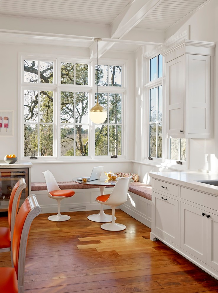 kitchen corner bench seating beautiful floor cool chairs windows wall cabinet round top table laptop hanging lamp farmhouse room