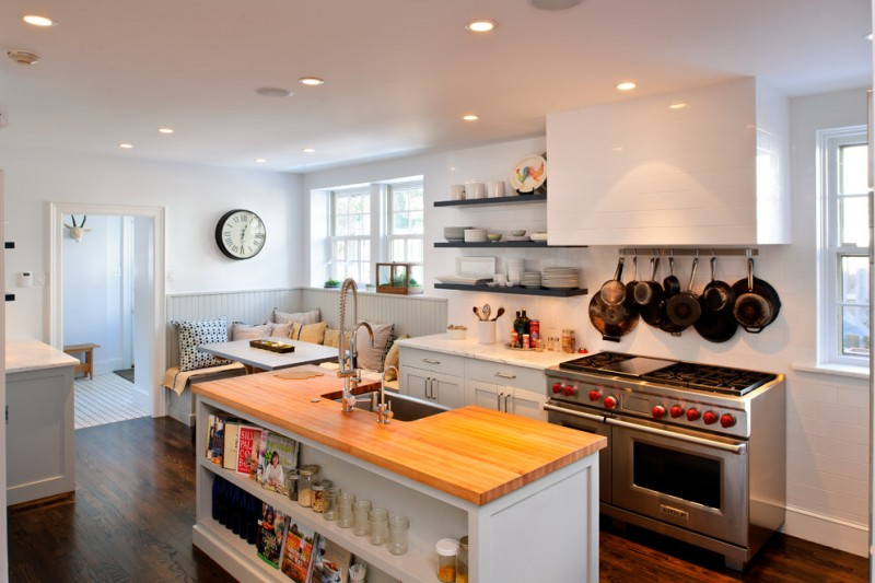 kitchen corner bench seating ceiling lights beautiful wood floor island shelves windows stove pillows table transitional room