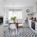 kitchen corner bench seating cool floor patterns chairs pillows window books shelves hanging lamp stove clock contemporary room