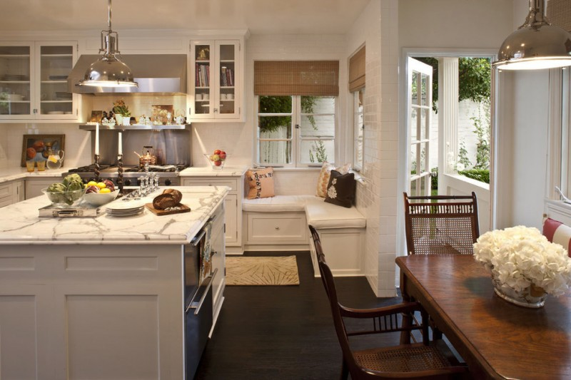 kitchen corner bench seating glass front cabinets island chairs table cool lamps window pillows traditional room