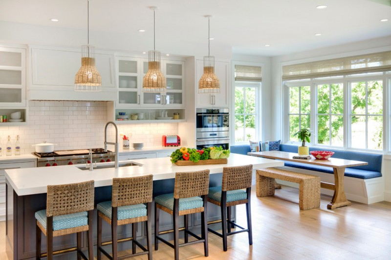 kitchen corner bench seating island chairs ceiling lights table hanging lamps cabinets beach style room big windows