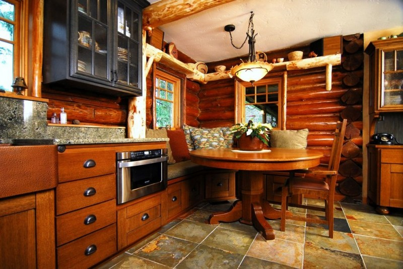 kitchen corner bench seating pillows table chair wall cabinets beautiful lamp windows logs rustic room