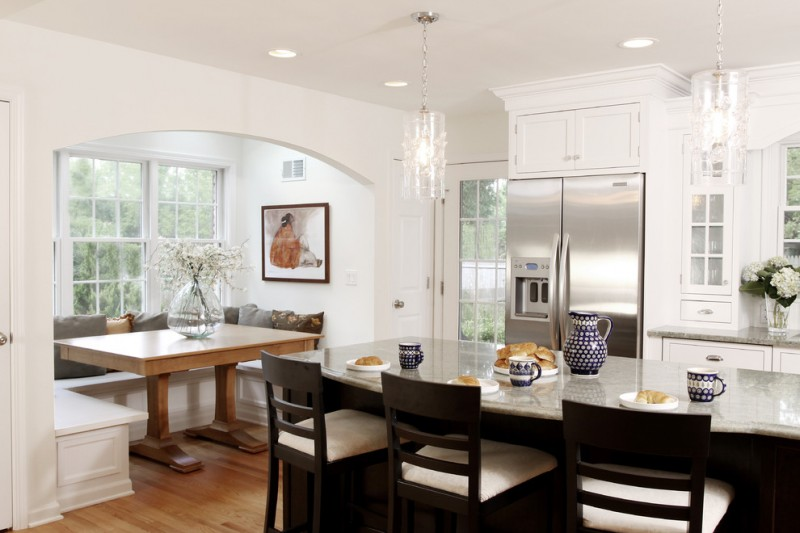 kitchen corner bench seating pillows window chandeliers chairs table fridge cabinet flowers ceiling lights traditional room