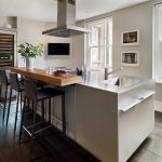 Kitchen Island With Wooden Added Block For The Bar Seating, With Black High Stool With Backs
